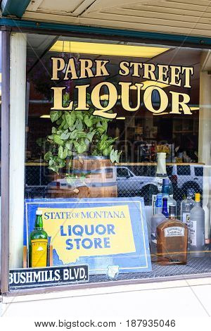 Butte, Montana, USA - 07/21/2015: Park Street Liquor store window advertised as an official State of Montana Liquor store in Butte