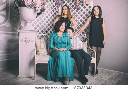 Mature mother in evening dress and her children, Asian family