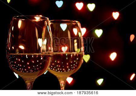 Wine Glass On Hearts Bokeh Background