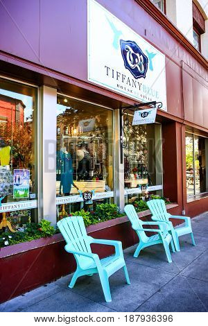 Coeur d'Arlene, ID, USA - 07/19/2015: Plastic chairs outside the Tiffany Blue fashion store on Sherman Ave in Coeur d'Alene in Idaho