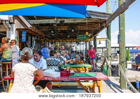Cortez, FL, USA - 05/19/2015: People enjoying the food at the waterfront fish restaurant at Cortez in Florida