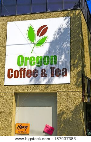 Corvalis, OR, USA - 07/14/2015: Overhead sign for the Oregon Coffee and Tea store in Corvallis Oregon