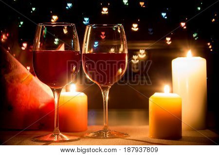 Wine Glass On Hearts Bokeh Background
