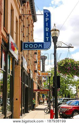 Fargo, ND, USA - 07/24/2015: Overhead signs seen on N. Broadway Dr in downtown Fargo N. Dakota