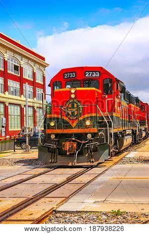 Fargo, ND, USA - 07/24/2015: Orange Loco of the BNSF (Burlington North Santa Fe) railroad in Fargo N.Dakota