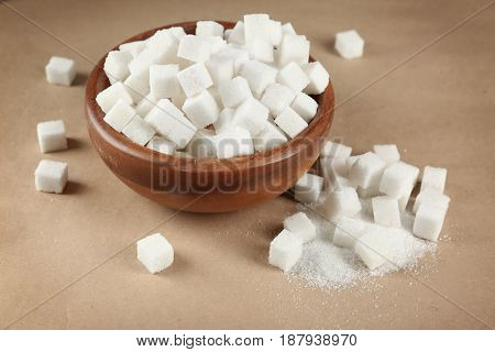 Bowl with sugar cubes on table