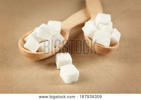 Spoons with sugar cubes, closeup