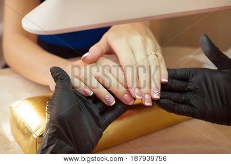 We will take a nail polish girl in a beauty salon