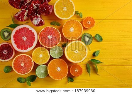 Beautiful composition with fresh fruits on wooden background