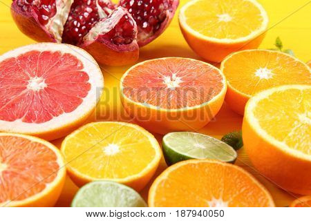 Beautiful composition with citrus fruits on wooden background