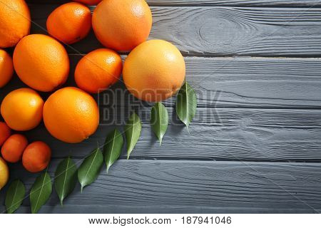 Beautiful composition of citrus fruits on wooden background