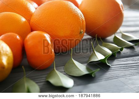 Beautiful composition of citrus fruits on wooden table