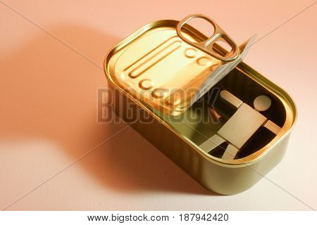 Figure in Tin Can on Warm Background
