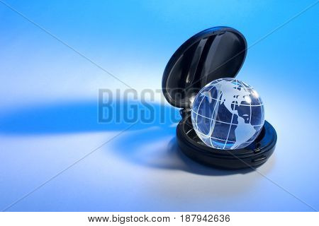 Globe in Compact Case on Blue Background