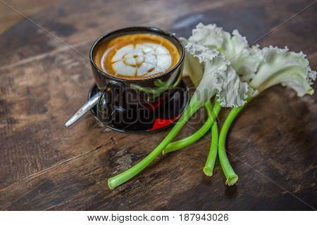 hot coffee with foam milk art of love. White cup of coffee. Coffee cup. Coffee break