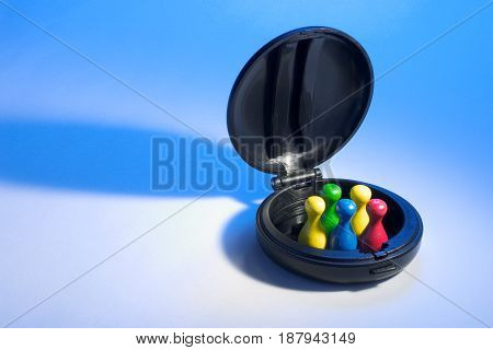Game Pieces in Compact Case on Blue Background