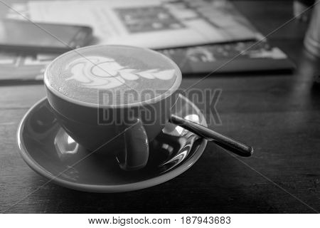 Art-shaped pattern of coffee latte art With a relaxing time