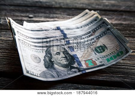 money on a wooden background. lot 100 dollars, business composition