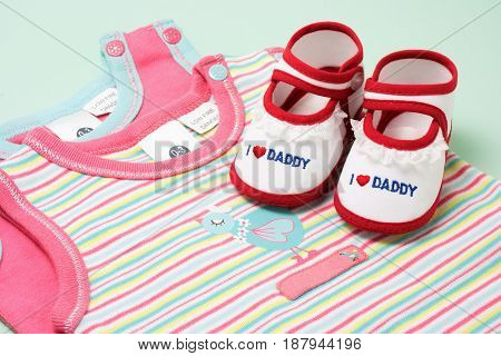 Assorted Baby Items on Light Blue Background
