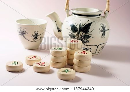 Teapot and Cup with Chinese Chess Pieces
