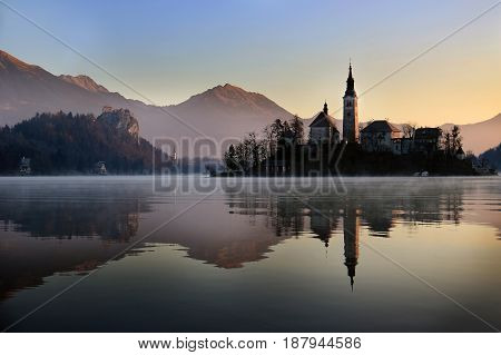 The church of Assumption reflection during sunset Bled Slovenia.