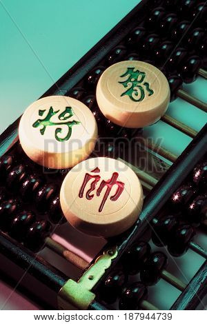 Chinese Chess Pieces on Abacus with Green Background