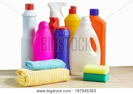 Bottles of cleaning products sponge and rag for cleaning the home on white background
