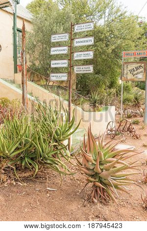 DE RUST SOUTH AFRICA - MARCH 23 2017: Signposts at a shop selling handmade goods in De Rust a village in the Western Cape Province of South Africa
