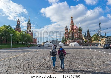Walking on St. Basil's Descent Square in Moscow Russia