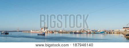 SALDANHA BAY SOUTH AFRICA - APRIL 1 2017: A panorama of the harbor in Saldanha Bay a town in the Western Cape Province