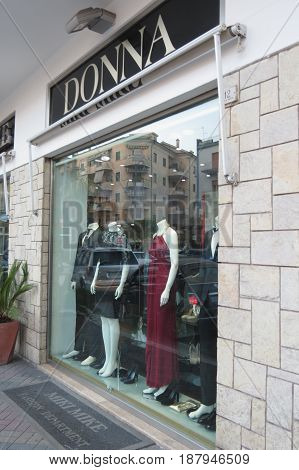 CASSINO ITALY - CIRCA OCTOBER 2015: store front of a Donna clothes' store with reflections on the window