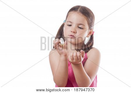 Young girl holding a open fortune cookie. Isolated over white background