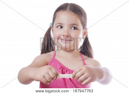 Young girl holding the paper of fortune cookie. Isolated over white background