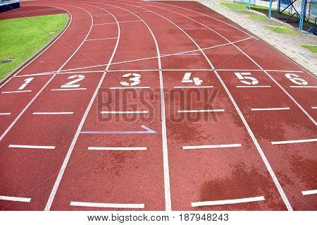 Red running racetrack on the outdoor stadium