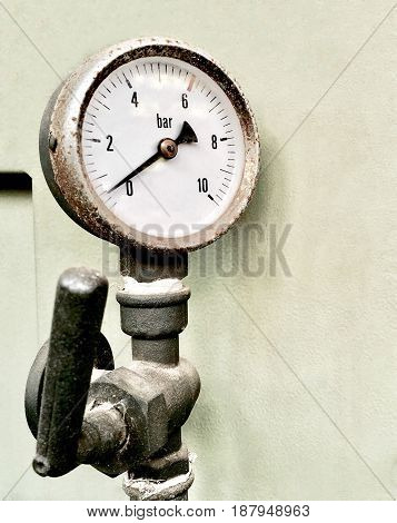 Old Rustry Manometer or Pressure Gauge of Heating System in A Boiler Room.