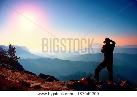 Professional Photographer Takes Photos With Mirror Camera On Peak Of Rock. Dreamy Fogy Landscape, Sp
