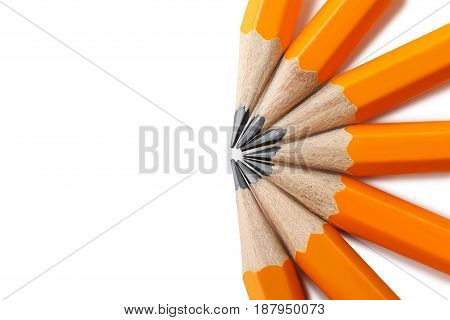 Yellow pencils on a white background, close up