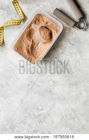 Fitness nutrition with bars and measure tape on stone table background top view mock-up