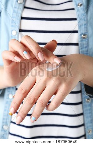 The Young woman hands with the cream