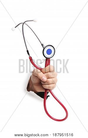 Male hand with stethoscope punching through the paper