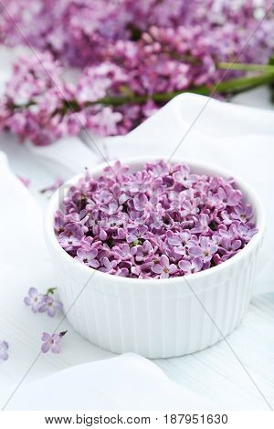 Lilac Flowers In Bowl On White Cloth