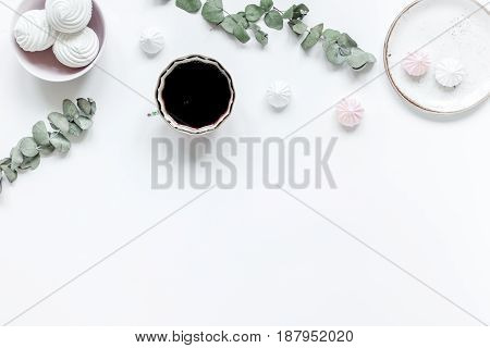 woman desk with plant, coffee and marsh-mallow in spring breakfast desing on white background flat lay mock-up