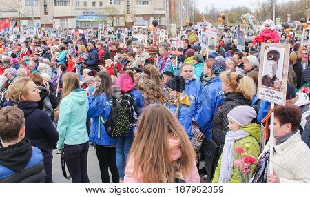 Kirishi, Russia - 9 May, A crowd of people with portraits, 9 May, 2017. Holding a festive rally dedicated to the Victory Day.