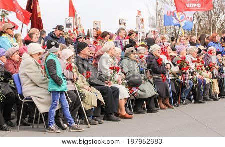 Kirishi, Russia - 9 May, Sitting with flowers, veterans, 9 May, 2017. Holding a festive rally dedicated to the Victory Day.