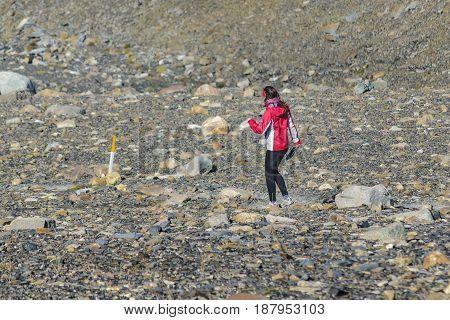 Young Woman Walking At Trekking Road. El Chalten  - Argentina