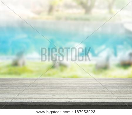 Table Top And Blur Swimming Pool Of Background