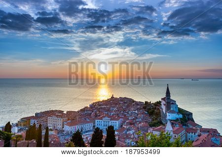 Lovely Adriatic town of Piran in sunset with a few clouds in the sky