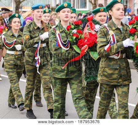 Kirishi, Russia - 9 May, Crowned group of girls, 9 May, 2017. Preparation and conduct of the action Immortal regiment in small cities of Russia.