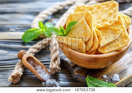 Crackers With Salt In A Wooden Bowl.