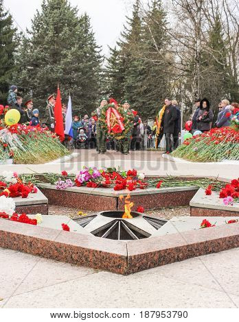 Kirishi, Russia - 9 May, Ceremonial ritual at the Eternal Flame, 9 May, 2017. Laying wreaths and flowers in memory of the fallen at the Eternal Flame.